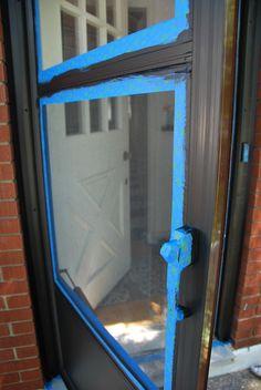 Painting a metal screen door.