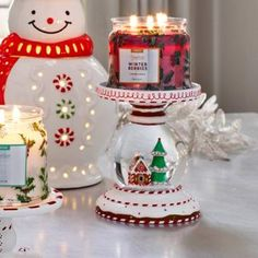 Product Image of Let It Snow Jar Holder shown with lit candle