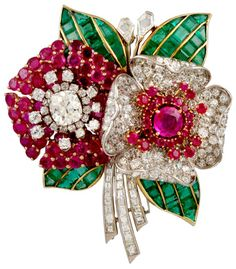 Circa 1930's Tri-Color Diamond,Ruby & Emerald Flower Brooch.   Platinum, 18kt. Yellow & Pink Gold Diamond, Ruby & Emerald Flower Brooch. Via 1stdibs.