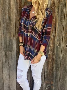 "A button down plaid top with one front pocket and a high low hem. Long sleeves. Unlined.  100% Rayon 26"" length Measured from size small, laid flat Hand wash cold  Model Stats: Height: 5""7, Bust: 34, Waist: 26, Hip: 36  
