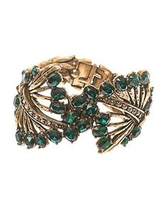 OSCAR DE LA RENTA Jewelled leaf cuff -   Introduce an antiquated charm to day or evening looks with Oscar de la Renta's cuff. This beautiful piece was inspired by the designer's love of gardening – an influence reflected by the green and silver Swarovski crystal-encrusted leaf design – and is hand-set in Russian gold-tone brass.
