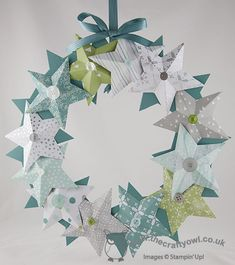 Today I thought I would share with you the Christmas star wreath I made at my class yesterday. I used the All is Calm Speciality Designer Series Paper for my version, which looks like this:  I layered