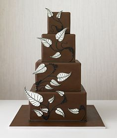 Tiered chocolate cake decorated with leaves - this reminds me of a cartoon cake come to life!  Love the black and white against the chocolate brown.