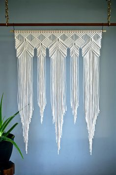 This large macrame wall hanging was made from 3mm natural white cotton rope and hangs from a natural wooden dowel. A unique piece that is sure to add texture and interest to any room! Would make a lovely gift!  Wooden dowel is 36 and measures approx. 48 long (3 x 4).  This item is READY TO SHIP!  ✦ 48 Dowel Version ✦ www.etsy.com/listing/289808143  ✦ Wedding Arch Version ✦ www.etsy.com/listing/477135947  ✦ Shop Dowel Wall Hangings ✦ www.etsy.com/shop/BermudaDream...