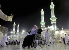 An elderly pilgrim poses for a picture in front of the Grand Mosque in the holy city of Mecca Saudi Arabia on Oct. 8 2013.  (AP photo) http://tnie.in/GO30JO