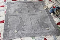 This adorable blanket has 4 embossed designs of bunnies, with a framed edging in garter stitch. One can optionally embroider the tails with a contrasting color for an added interest.