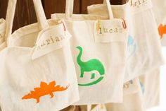 Dino party favor bags-- you could do any stencil or simple applique for a nice favor bag/tote