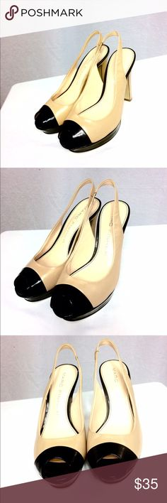 """Marc Fisher Tan/Black Leather Peep-Toe Pumps (5M) These heels have been preloved, but are still in good condition!  The uppers are a combination of leather & man made, & are in great shape!  The soles are man made & have some wear.  They have a stretch slingback heel. The heels measure about 4.5"""" high, but there is a 1"""" platform on the ball of the foot, so they only really feel like they are 3.5"""" high. Cute & classy! Easy to wear with a wide range of outfits due to the nude & black coloring…"""