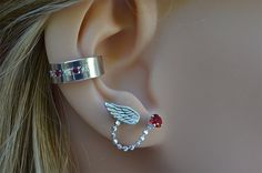 Check out this item in my Etsy shop https://www.etsy.com/listing/243905559/angel-wing-and-a-birthstone-stud-earring