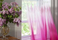 Turn a light and airy ombré scarf into a café curtain using drape clips and rope!