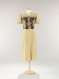 Dress  Jessie Franklin Turner (American, 1881–ca. 1956)  Date: ca. 1937 Culture: American Medium: wool, wood