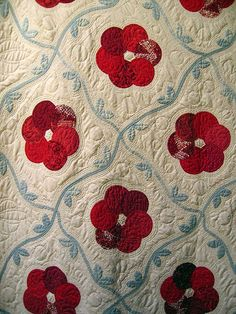 applique vine sashing -the flowers are overlapping circles...one could make them raw edge applique.