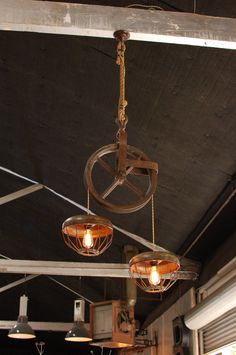 Big Daddy's Antiques custom pulley light with chicken feeder shades and Edison bulbs