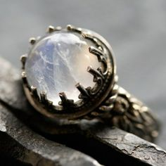 Intricate ring with stone. Unknown artist.