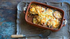 Greek Baked eggplant with haloumi and kasseri Cheese (pseftomousakas) _ Sometimes referred to as fake moussaka due to the omission of meat and potatoes, this recipe is a great vegetarian dish that doesn't compromise on flavour. Miso Eggplant, Baked Eggplant, Eggplant Recipes, Eggplant Moussaka, Grilled Eggplant, Greek Recipes, Veggie Recipes, Vegetarian Recipes, Cooking Recipes