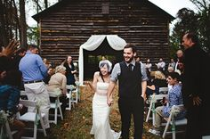 picturesque barn wedding, complete with Topo bottles filled with baby's breath adorning the aisle!