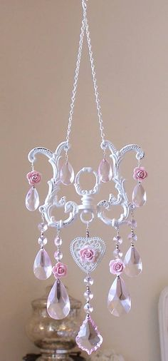 Diy suncatcher made from chandelier parts and porcelain roses...doing this with my pearl brads instead of the roses.