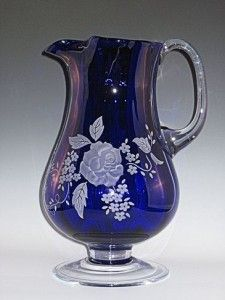 You can find this Badash Cobalt Pitcher anywhere on the web.  But you won't find it like this one.  This one-of-a-kind piece is hand blown glass with a custom rose pattern cameo carved into the pitcher.  The design is carved all the way around the pitcher.  What an exceptional and unique gift idea.  #sl630 badash cobalt pitcher, #decorative glass pitcher
