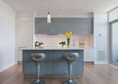 I like the matte white contrasting the glossy grey cabinetry playing off the wood flooring. Scavolini mood modern kitchen. glossy grey lacquer. tactile textured wood veneer in white.