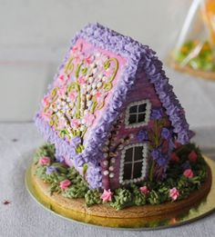 Easter Gingerbread House with spring color icing. Gingerbread Village, Christmas Gingerbread House, Gingerbread Man, Gingerbread Cookies, Christmas Cookies, Christmas Crafts, Ginger House, Cookie House, Cookie Cottage
