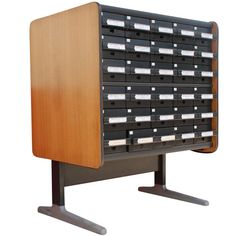 George Nelson For Herman Miller Card Cabinet. 1970's  A mid century modern library card catalog cabinet designed by George Nelson and made by Herman Miller. An extruded aluminum base, walnut veneer sides, and thirty drawers.