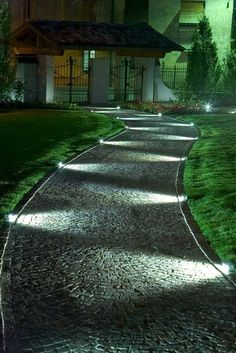 led lights bathe a walkway ..sidelight emphasizes texture......cool effect