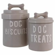 "Stow pet treats in style with these charming ceramic canisters, showcasing bone-shaped handles and typographic motifs.  Product: Small and large lidded canister Construction Material: CeramicColor: GreyFeatures: Bone-shaped handlesDimensions: Small: 9"" H x 6"" DiameterLarge: 10.5"" H x 6"" Diameter"