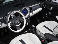 The interior of the two millionth MINI, a White Silver Metallic MINI Convertible with Denim Blue top.