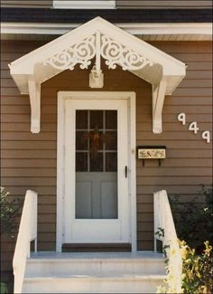 Floating porch hood – Victorian portico over door - Front Door Ideas House With Porch, House Front, Porch Hood, Casas Country, Door Overhang, Victorian Porch, Porch Kits, Small Front Porches, Balkon Design