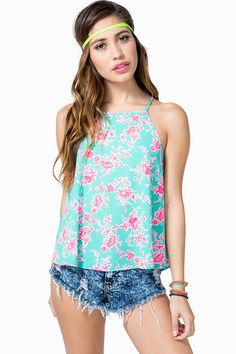 Catch some spring fever in this blooming halter top! Neon floral print. Sleeveless. Keyhole back with a button loop closure. Spaghetti straps. Finished hem.