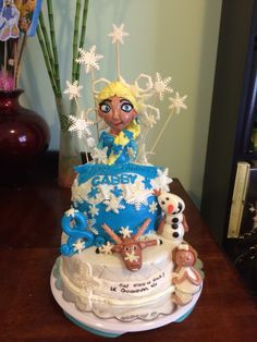 Queen Elsa edible topper and birthday cake with a 1st communion cake all together