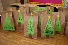 Mrs. Ricca's Kindergarten ~ cute way to wrap student's gifts for parents.  Like the snowman handprint ornaments