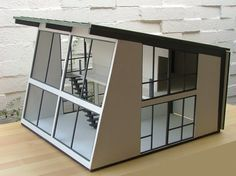 If I ever get myself (or my children) a dollhouse its going to be like this mid-century modern dollhouse...