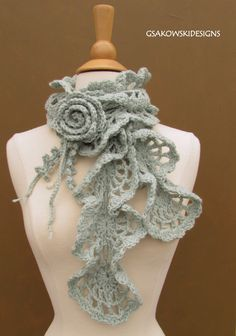This sweet scarf is very stylish, fashionable and romantic. Its very feminine and can be worn either casually or on those special occasions. It's hand crochet from beautiful, soft 100 % wool yarn in lace pattern. The flower has hand sewn crystal bead and has a bar pin back which can be easily removed and used on other items. It was made in a smoke-free environment. Handmade with great care and love. Never been worn. Care Instructions: Hand wash with mild detergent. Dry flat. Details:...