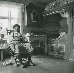 Norwegian Setesdal woman in her home.