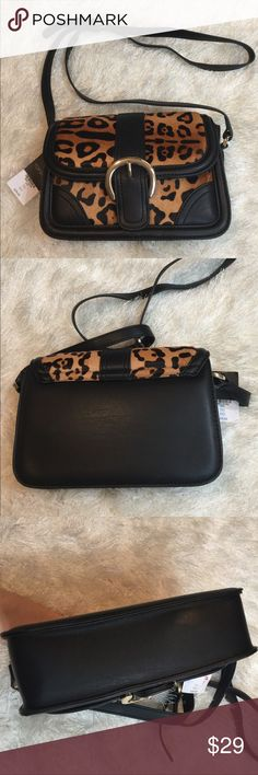 TopShop leopard print crossbody purse Awesome crossbody- black & brown means you can wear with everything. Good size to hold all your things. Measures 9 x 6.5 x 2. Has one inside zipper pocket. Also has one inside pocket to slide an ID or Cc in. I have 2 of these available; spots are unique to each bag (the leopard). Bundling is fun! Check out my other items. No trades or holds. No spam. Topshop Bags Crossbody Bags