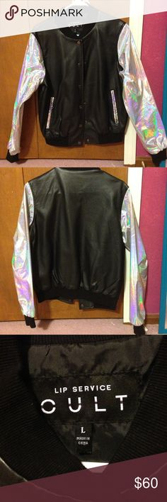 "Holographic bomber jacket by urban outfitters Holographic sleeves and pocket details. It is vegan leather and a vinyl material. In great condition with no peeling. Size large but I'm an extra small and it fits me and doesn't fit my friend who is a large. Authentic urban outfitters jacket from seasons ago. It looks amazing under the sunlight or flash and really showcases the ""holo"" if you're a holosexual then this jacket is perfect for you! Perfect for a street look or for a club! I'll unlist…"