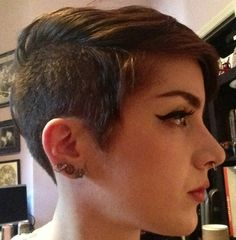 Pixie with shaved sides, long bangs.