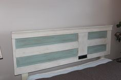 I created this headboard from an old door. My favorite project yet!!