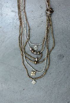 Love Raven + Lily. Proceeds help provide healthcare and education for women and children in their partnership communities.     This necklace is made from melted down bullet shells from former war conflict in Ethiopia.