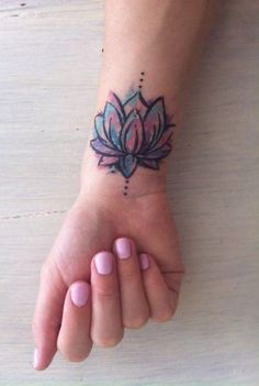 Watercolor Lotus Floral Flower Wrist Tattoo Ideas for Women at MyBodiArt.com