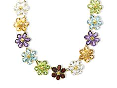 A garland of the most perfect blossoms has been crafted in shimmering gemstones! Linked flowers are formed with pear-cut blue topaz, peridot, garnet, white topaz, citrine and amethyst in a necklace of 14K gold. Piece measures 17 1/4 by 9/16 inches.