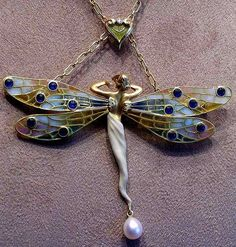 Jewelery in the Art Nouveau period used nature as the principle source of inspiration, complemented by new levels of virtuosity in enameling and the introductions of new materials such as semi-precious stones and opals.    Art Nouveau Winged Fairy.