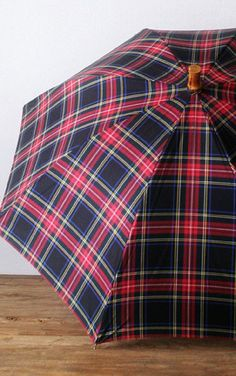 Love this red and black plaid umbrella