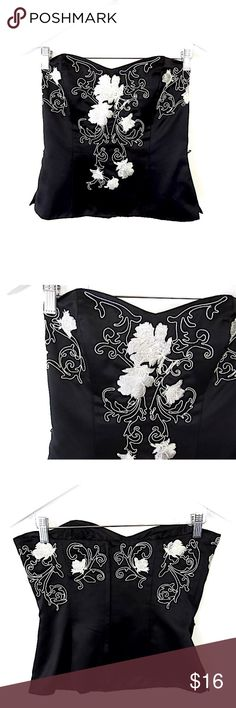 """WHBM Embroidered Satin Bustier Sz 6 Brand: White House Black Market  Style: Strapless Corset Bustier, back zip  Size: 6  Color/Pattern: Black with ivory floral embroidery  Material: Polyester Measurements taken flat:   -Across under arm: 17"""" -Shoulder to hem: 16"""" Garment Care: dry clean Condition: Missing waist tie. White House Black Market Tops Blouses"""