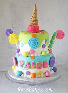 This cake has lots of lollipops and candy and an ice cream cone on top!  It's bright and colorful and precious for a little girls fantasy Candyland party!