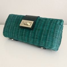 "J. Crew Teal Rattan Havana Clutch Made of a unique straw / wicker material. A great small purse for parties and weddings. 9"" long, about 2.5"" deep across the bottom. One slip pocket on the inside. Goldstone hardware with black patent leather style accents. J. Crew Bags Clutches & Wristlets"