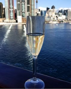 Sydney horizon. A glass of champagne in front of the city.  winegram.it share your wine