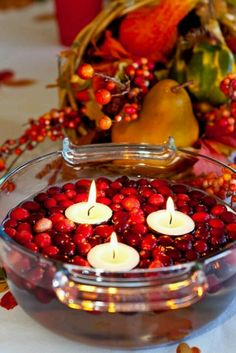 Simple! Cranberries and floating candles in a bowl!