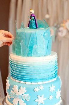 Disney's Frozen birthday party cake with Elsa! See more party planning ideas at CatchMyParty.com!